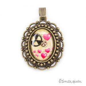 Petit pendentif fantaisie La Mécanique du Coeur bronze antique face Emilie Fiala